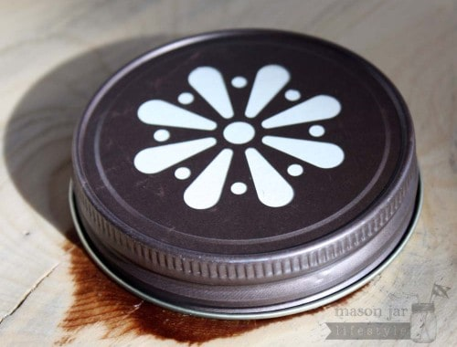 Vintage bronze daisy lid for Mason jars side