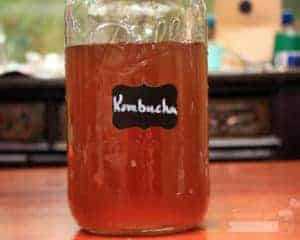Fancy rectangle chalkboard label on half gallon Mason jar with kombucha