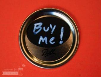 Oval chalkboard label on regular mouth Mason jar lid