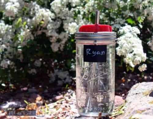 Rectangle chalkboard label in pint-and-a-half Mason jar with lid and straw
