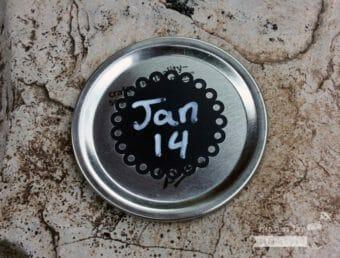 2 Inch round eyelet chalkboard sticker on wide mouth Mason jar lid