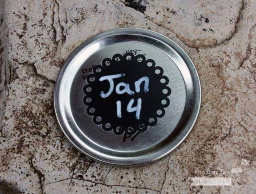 2 Inch round eyelet chalkboard sticker on wide mouth Mason jar lid