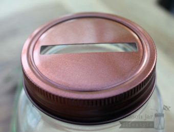 Copper colored coin slot lid for regular mouth Mason jars