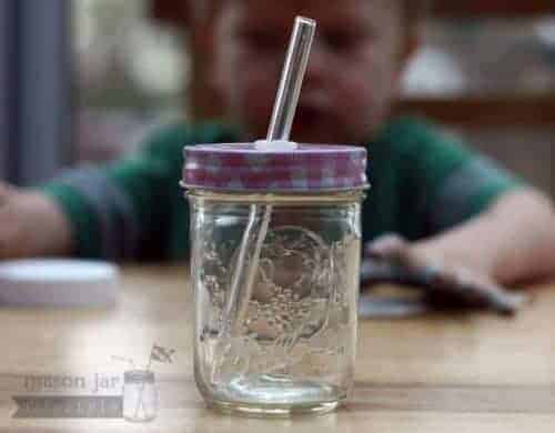 Glass straw in half pint Mason jar with pink gingham straw hole lid