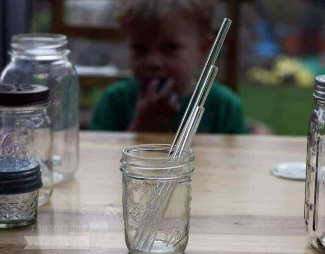 3 glass straws of different lengths in a half pint Mason jar