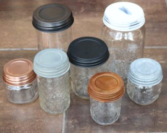 Decorative and primitive Mason jar lids with Ball Mason jars