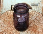Neck clip tea light candle holder on purple Ball Mason jar