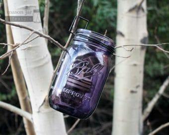Neck clip tea light candle holder on purple Ball Mason jar hanging on tree