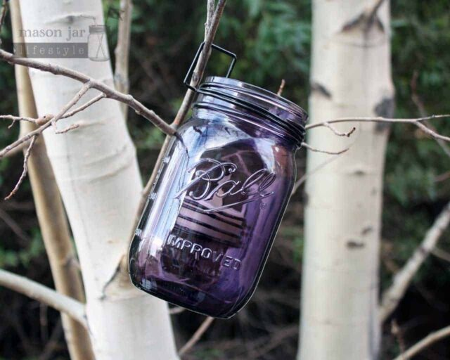 Neck clip tea light candle holder on purple Ball Mason jar hanging on tree