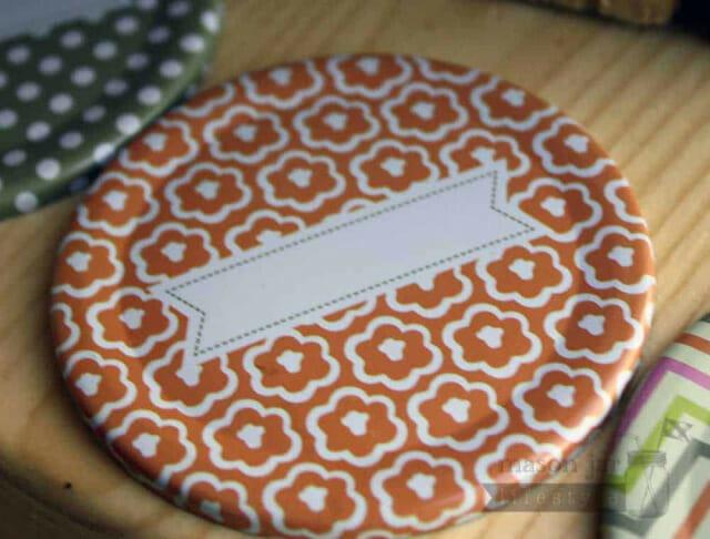 Orange flower pattern lid insert with label for regular mouth Mason jars