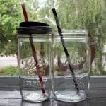 9 Inch red and black plastic straws with locking tabs in pint-and-a-half and quart Mason jars with lid