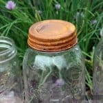 Rusted vintage reproduction lid on Atlas Mason jar