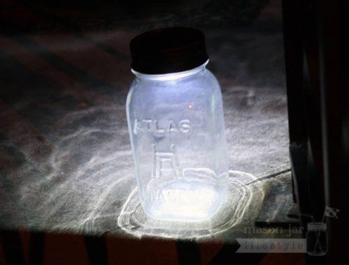 Solar light lid on Atlas Mason jar on front steps at night