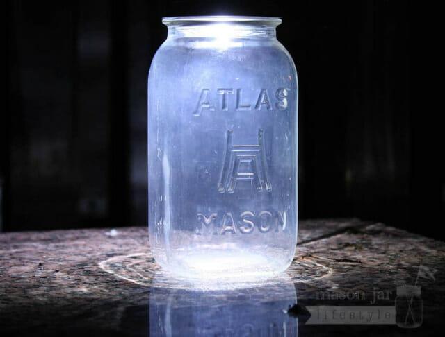 Solar light lid on Atlas Mason jar on granite bench at night
