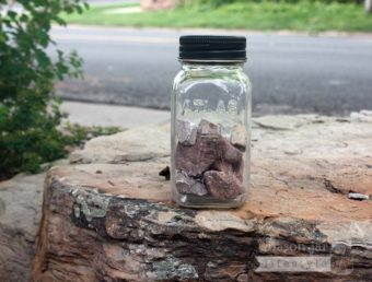 Solar light lid in black on Atlas Mason jar with rocks