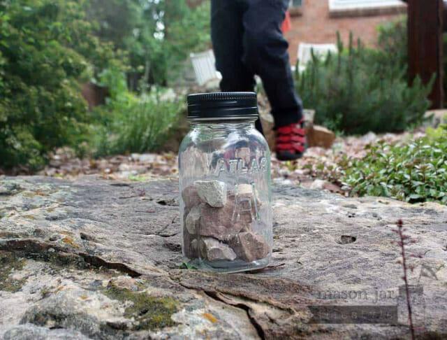 Solar light lid in black on Atlas Mason jar with rocks