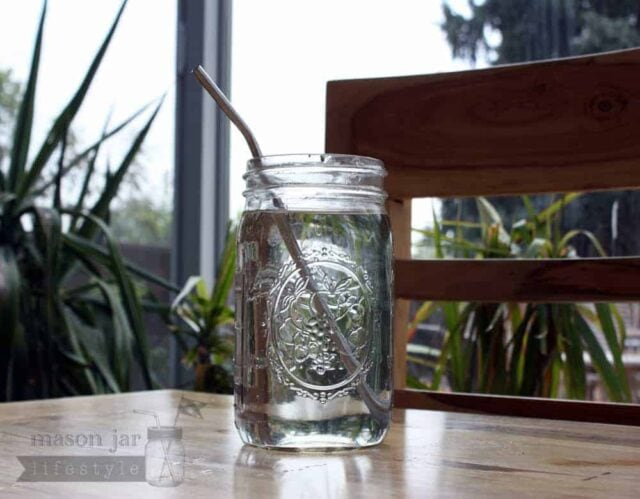 Quart jar with stainless steel straw on dining table