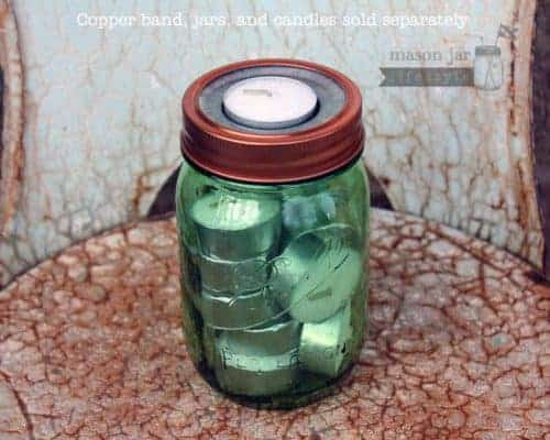 Metal tea light candle holder insert with copper band on green Ball jar with extra tea lights