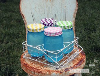 Vintage white caddy for 4 pint Ball Mason jars with chevron lids and glass straws