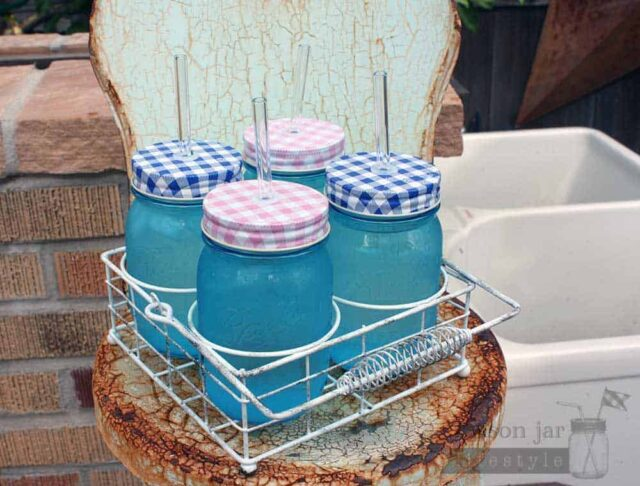 Vintage white caddy for 4 pint Ball Mason jars with gingham lids and glass straws