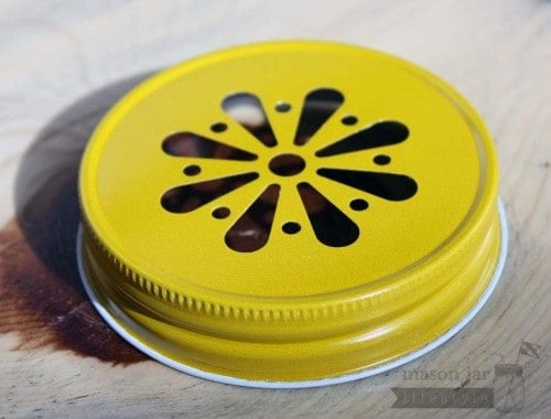 Yellow daisy lid for Mason jars side