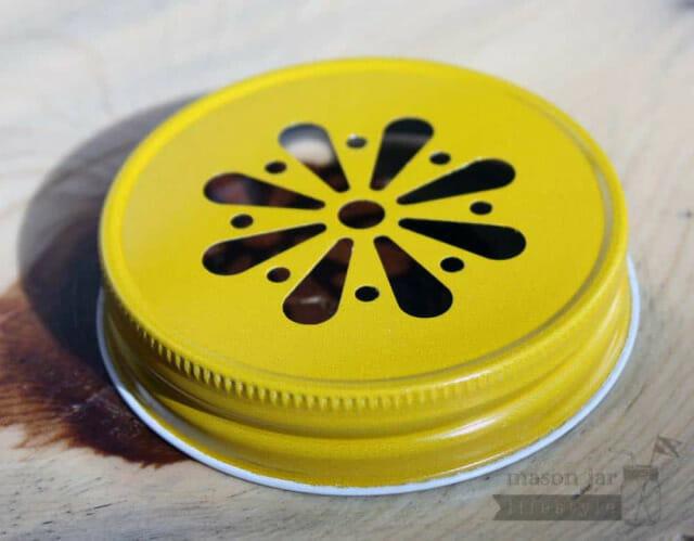 Yellow daisy lid for Mason jars side