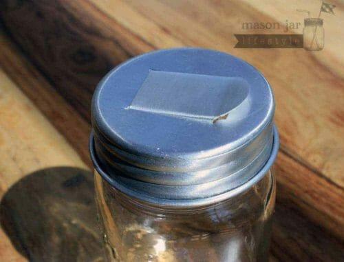 Aluminum grain dispenser lid for regular mouth Mason jars closed