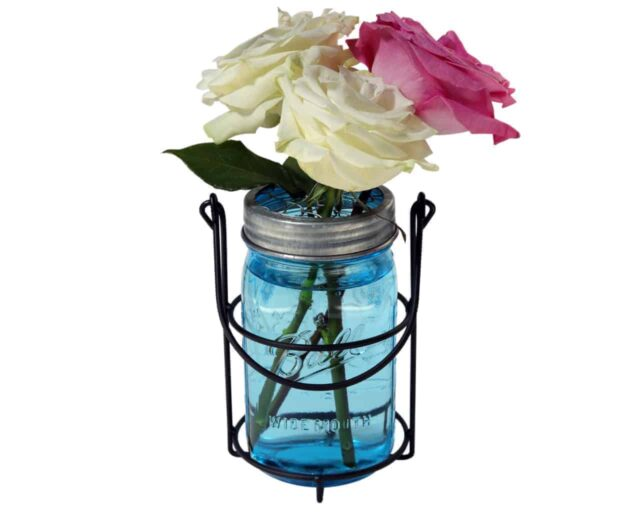 One jar caddy for hanging quart 32oz Mason jars with blue Ball jar, galvanized flower frog lid, and roses