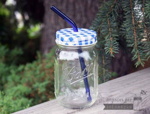 Blue glass bent straw in pint Ball jar with blue gingham lid
