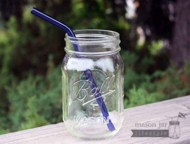 Blue glass bent straw in pint Ball jar