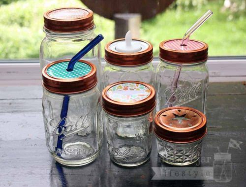 Copper rings / bands on six Ball Mason jars with different lid inserts