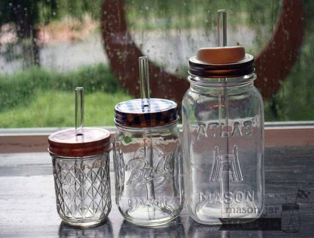Thick glass smoothie straws in half pint, pint, and quart Ball Mason jars with lids