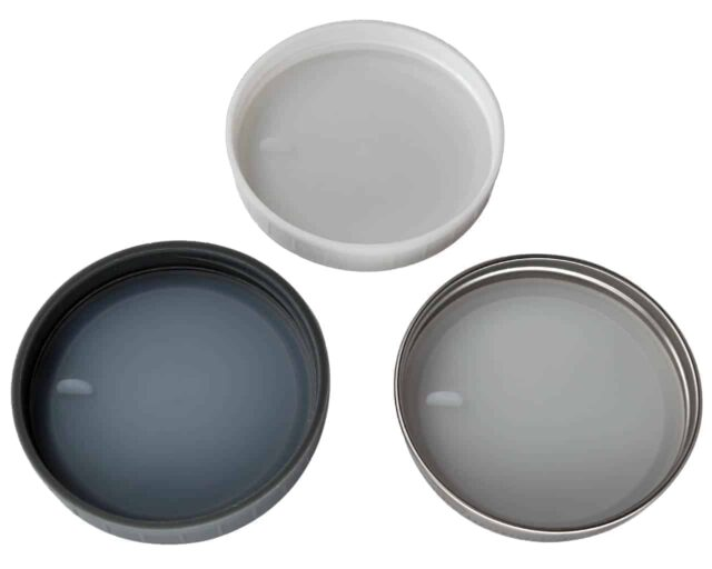 Platinum silicone lid liners with tabs in three different types of wide mouth lids. Leak proof and air tight. Use with a band as a lid, or as a liner inside other lids. Fully inserted.