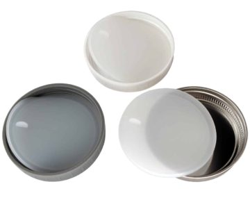 Platinum silicone lid liners with tabs in three different types of wide mouth lids. Leak proof and air tight. Use with a band as a lid, or as a liner inside other lids.