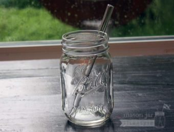 Thick glass smoothie straw in pint Ball Mason jar