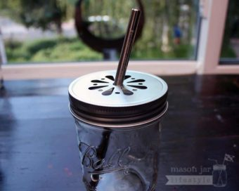 Safer rounded end stainless steel straw in wide mouth daisy lid on Ball pint jar