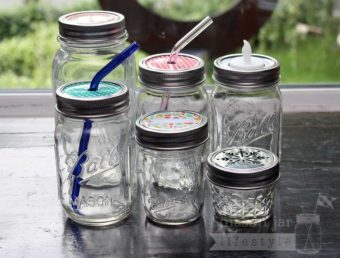 Stainless steel rust proof bands / rings on six Ball Mason jars with different lid inserts