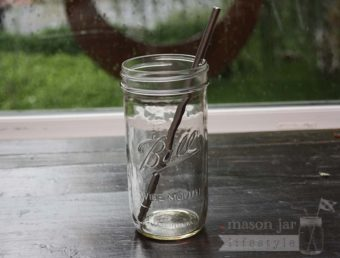Stainless steel straw with rounded ends in pint & half Ball Mason jar