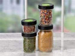 Ball herb shaker lids on 4 regular mouth Mason jars