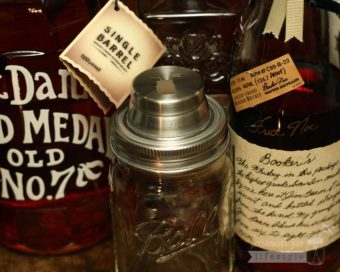 Mason jar cocktail shaker lid on Ball jar with Jack Daniels and Booker's bourbon