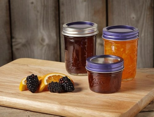 Ball purple lids and bands on 3 jars with jelly