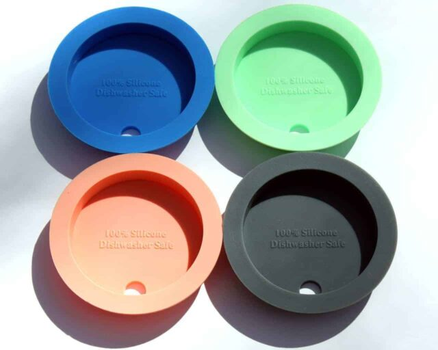 Bottom view - four colors of silicone fermenting and straw hole tumbler lids for wide mouth Mason jars