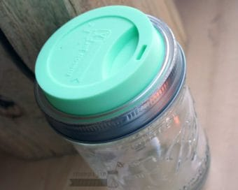Mint green Mason Jar Lifestyle silicone drinking lid on wide mouth pint & half Ball jar