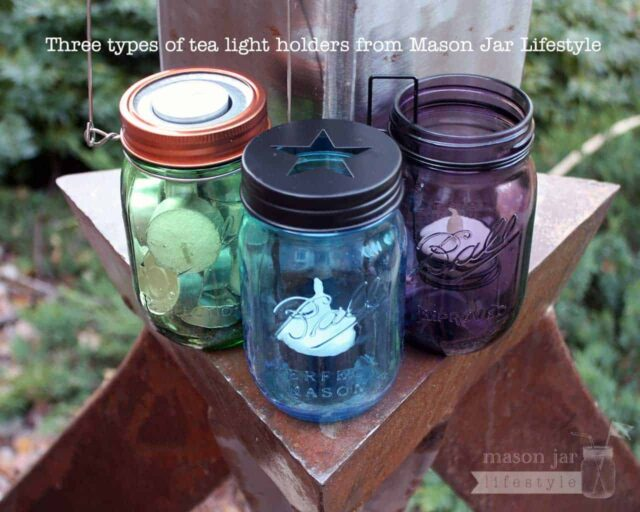 Three types of tea light candle holders on green, blue, and purple Ball Mason jars