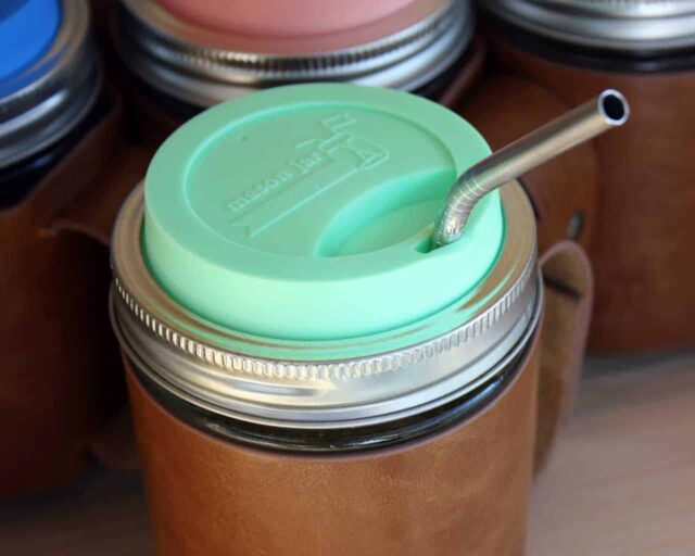 Thin bent stainless steel straw for pint Mason jars with mint green silicone drinking lid