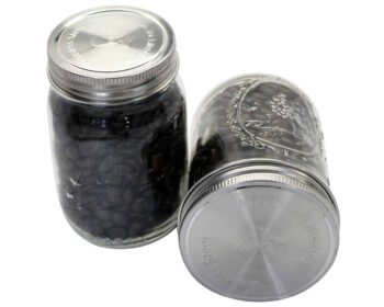 Mason Jar Lifestyle stainless steel rust proof storage lids with leak proof silicone seals on regular and wide mouth Ball pint jars with coffee beans