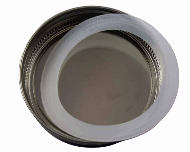 Stainless steel storage lid with removable silicone seal for wide mouth Mason jars