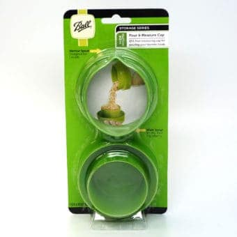 Ball pour and measure lid in package
