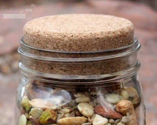 Cork lid stopper on wide mouth quart Kerr Mason jar with nuts