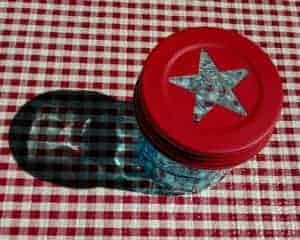 Red star lid on blue wide mouth pint Ball Mason jar